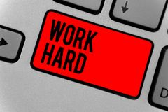 Text sign showing Work Hard. Conceptual photo Laboring that puts effort into doing and completing tasks Keyboard red key Intention. Create computer computing stock photos