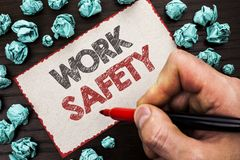Text sign showing Work Safety. Conceptual photo Caution Security Regulations Protection Assurance Safeness written by Man Holding. Marker Cardboard Piece the Royalty Free Stock Image