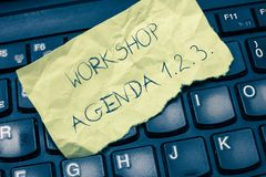 Text sign showing Workshop Agenda 1.2.3.. Conceptual photo help to ensure that Event Stays on Schedule.  Stock Image
