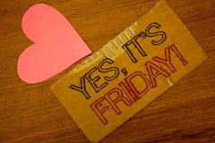 Text sign showing Yes, It'S Friday Motivational Call. Conceptual photo having weekend Taking rest break Peru color torn page with. Engraved black red text woody stock image