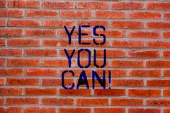 Text sign showing Yes You Can. Conceptual photo Positivity Encouragement Persuade Dare Confidence Uphold Brick Wall art. Like Graffiti motivational call written royalty free stock images