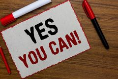 Text sign showing Yes You Can. Conceptual photo Positivity Encouragement Persuade Dare Confidence Uphold White paper red borders m. Arkers wooden background royalty free stock photo