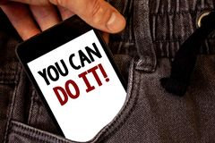 Text sign showing You Can Do It Motivational Call. Conceptual photo Inspirational Message Motivational Positive Text two words on. White screen black Phone Hand stock photos