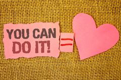 Text sign showing You Can Do It Motivational Call. Conceptual photo Inspirational Message Motivational Positive Text pink torn not. E equals is pink heart love Royalty Free Stock Image