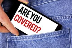 Text sign showing Are You Covered Question. Conceptual photo Health insurance coverage disaster recovery written on Mobile phone h. Text sign showing Are You Stock Image