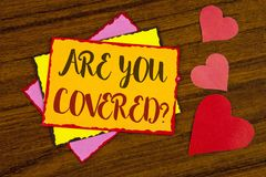 Text sign showing Are You Covered Question. Conceptual photo Health insurance coverage disaster recovery written on Sticky note pa. Text sign showing Are You Stock Photography