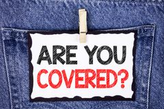 Text sign showing Are You Covered Question. Conceptual photo Health insurance coverage disaster recovery written on White Sticky N. Text sign showing Are You Stock Photos