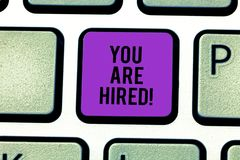 Text sign showing You Are Hired. Conceptual photo Receiving and invitation for an event Join us to celebrate Keyboard