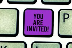 Text sign showing You Are Invited. Conceptual photo Receiving and invitation for an event Join us to celebrate Keyboard