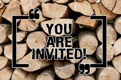 Text sign showing You Are Invited. Conceptual photo Receiving and invitation for an event Join us to celebrate Wooden