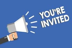 Text sign showing You re are Invited. Conceptual photo Please join us in our celebration Welcome Be a guest Man holding megaphone. Loudspeaker blue background royalty free stock photos