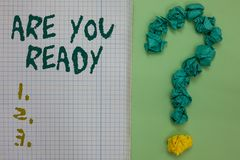 Text sign showing Are You Ready. Conceptual photo Alertness Preparedness Urgency Game Start Hurry Wide awake Notebook paper crumpl. Ed papers forming question stock image