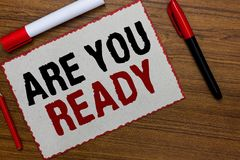 Text sign showing Are You Ready. Conceptual photo Alertness Preparedness Urgency Game Start Hurry Wide awake White paper red borde. Rs markers wooden background royalty free stock images