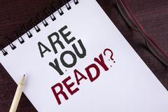 Text sign showing Are You Ready Question. Conceptual photo Prepare well to face upcoming business changes written on Notepad on th. Text sign showing Are You Stock Photo