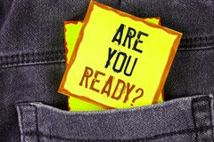 Text sign showing Are You Ready Question. Conceptual photo Prepare well to face upcoming business changes written on Yellow Sticky. Text sign showing Are You Stock Photo