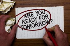 Text sign showing Are You Ready For Tomorrow question. Conceptual photo Preparation to the future Motivation Hand hold paper lob a. Nd red pen red circled black stock images