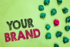 Text sign showing Your Brand. Conceptual photo A name of any kind that is impacted to something as trademark Crumpled wrinkled pap stock photo