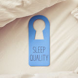 Text sleep quality in a door hanger Royalty Free Stock Photo