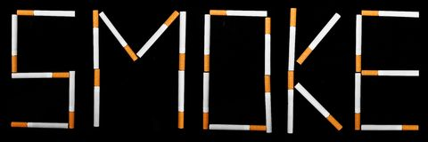 Text Smoke made from cigarettes Stock Photography