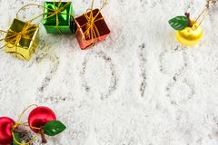 2018 text on the snow with Christmas and New Year decoration.  Royalty Free Stock Images