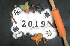 2019 text made with flour with decorations on a black background. 2019 text, snowflakes  made with flour with decorations on a black background. Flat lay. Merry royalty free stock photos