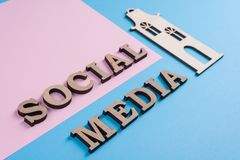 Text social media abstract wooden letters. People connecting and sharing social media. Text social media abstract wooden letters. Blue background with the image stock image