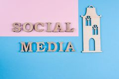 Text social media abstract wooden letters. People connecting and sharing social media. Text social media abstract wooden letters. Blue background. People royalty free stock image