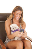 Text someone holding on to a dog Royalty Free Stock Photo