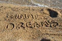 Text-Sommer-Träume auf Strand Lizenzfreies Stockfoto