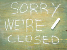 Text sorry we are closed. Written with chalk in old board  wooden Stock Image