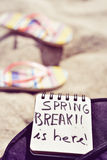 Text spring break is here in a notepad Stock Photos