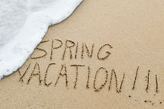 Text spring vacation in the sand of a beach Royalty Free Stock Images
