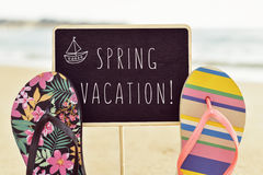 Text spring vacation in a signboard royalty free stock image