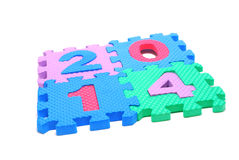 Text 2014 Square. Text 2014 Made of Children Puzzle Parts Isolated on White Royalty Free Stock Photo