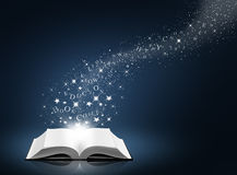 Text, star and snow on open white book. Blue background royalty free stock photos