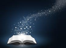 Text, Stern und Schnee auf geöffnetem weißem Buch Lizenzfreie Stockfotos