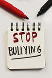 Text stop bullying in a notebook Royalty Free Stock Images