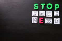 Text STOP FAKE NEWS on dark background stock images
