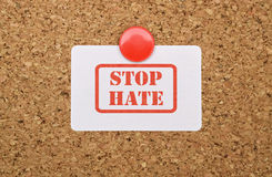 Text Stop Hate. Written on a white sticker pinned on cork board Royalty Free Stock Image