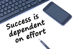 Text Success is dependent on effort Stock Images