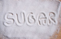 Text sugar on sugar  background Stock Photos