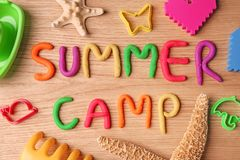 Text SUMMER CAMP made with play dough. On wooden background, top view Stock Images