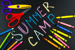 Text Summer camp written with chalk on chalkboard stock photography