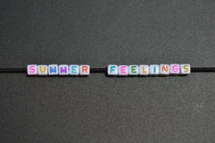 Text 'Summer Feelings' Stock Images