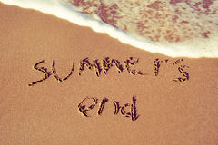 Text summers end written in the sand of a beach Stock Photos