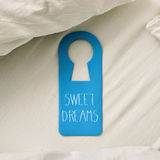 Text sweet dreams in a door hanger Royalty Free Stock Photo