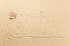 Text and symbols in the sand Royalty Free Stock Photos