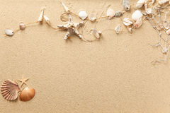 Text and symbols in the sand Stock Photos