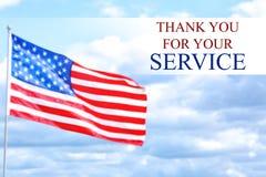 Text TACKAR DIG FÖR DIN SERVICE med USA flaggan royaltyfria foton