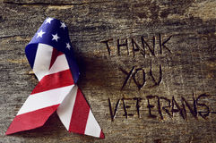 Text tackar dig veteran och flaggan av USA royaltyfri bild